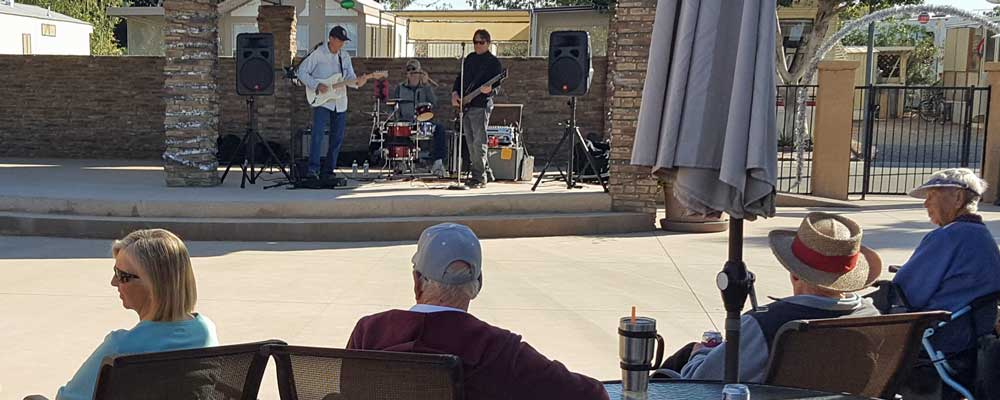 Arriving at our new RV parking location to a live band at the clubhouse