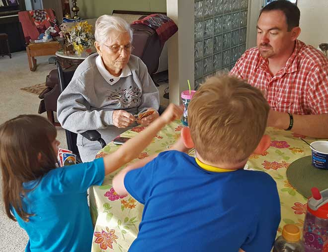 Great Grandma playing Uno with the kids