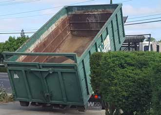 The dumpster arrives