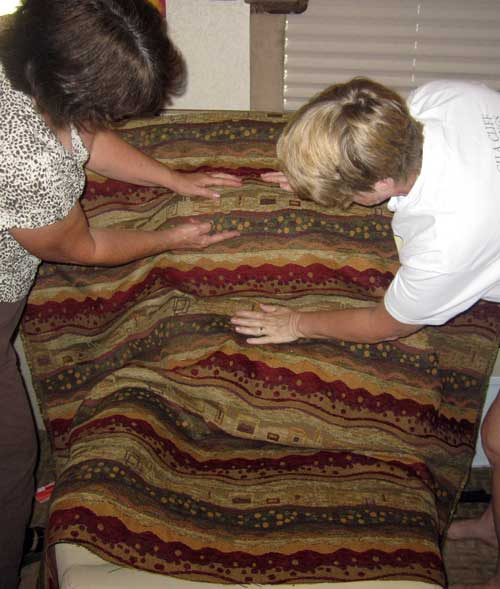 Sandy and Gwen examine the new upholstrey fabric
