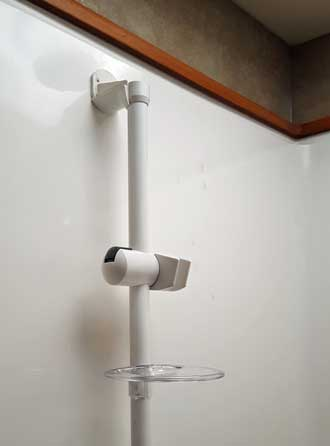 Adjustable shower head rod