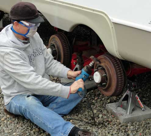 I'm getting the rust off the trailer drum brakes, preparing to paint them