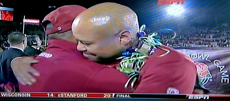 David Shaw hugs his father after Stanford's win at the Rose Bowl