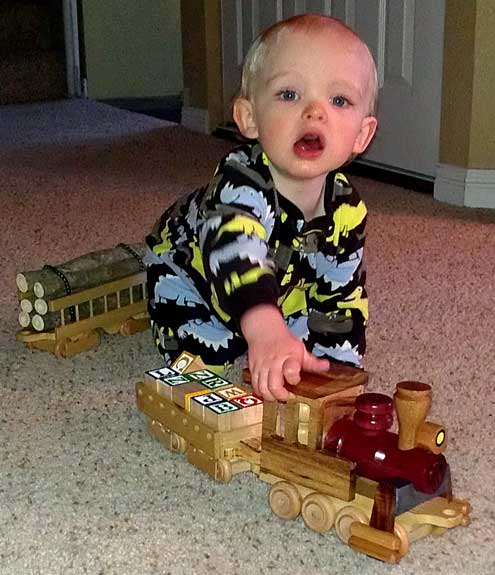Noah makes train noises as he pushes his yard engine