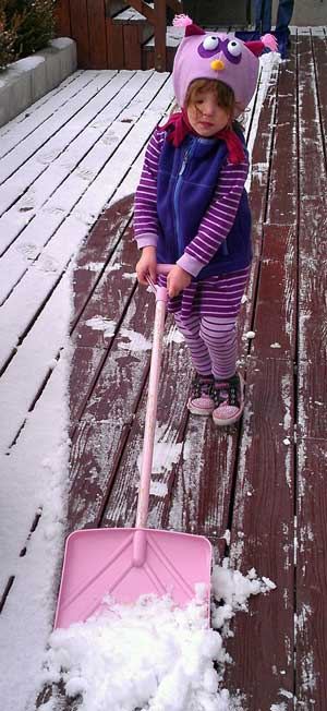 Chloe shoveling the snow off her deck in Reno, NV
