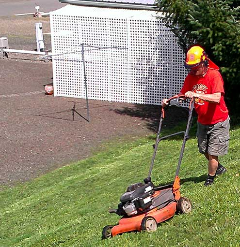 Mowing a portion of the park which can't be mowed by the riding mower