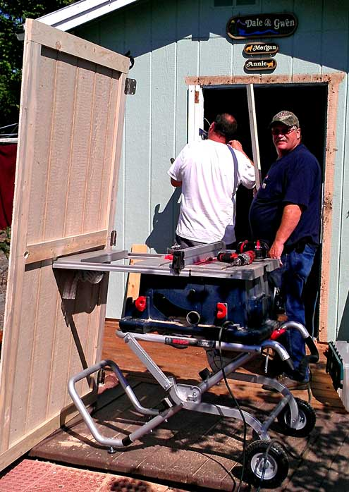 Randy and Greg install a new door on our shed