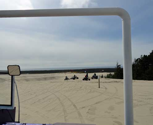 Some 4 wheel ATVs in the distance on the Oregon Dunes