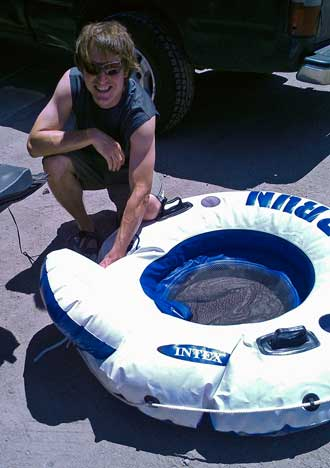 Scott is inflating the tubes for a float down the Truckee River