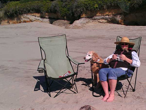 Gwen enjoying the Tillicum beach, Behind: Dale rests after flying his parafoil kite