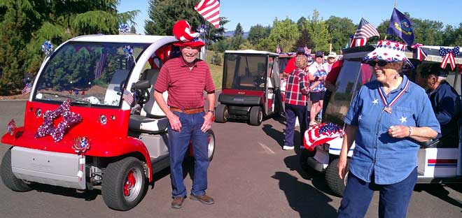 Preparing for the Independence Day golf cart parade, Behind: It's a Timber Valley tradition