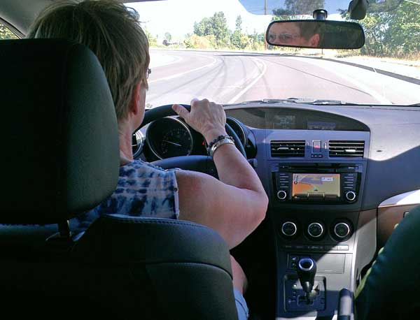"Gwen test drives a Mazda 3, Behind: Total ""fun-factor"" vehicle, worthless as anything else"