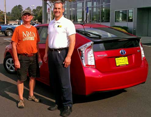 Dale with Will Baas handing over the car, Behind: The Prius engine