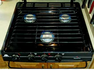 The stove top purchased with the Alumascape, Behind: The new range is installed