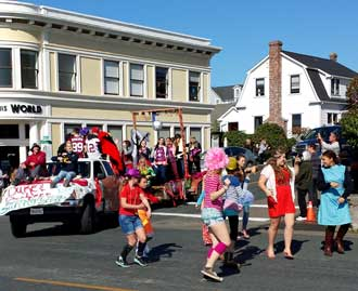 "Homecoming parade time in downtown Mendocino, Behind: another of the ""Duke and Duchese candidates"