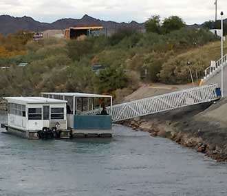 The free boat to cross the Colorado River from Arizona to Nevada for the casinos, Behind: The Riverside in Laughlin, Nevada