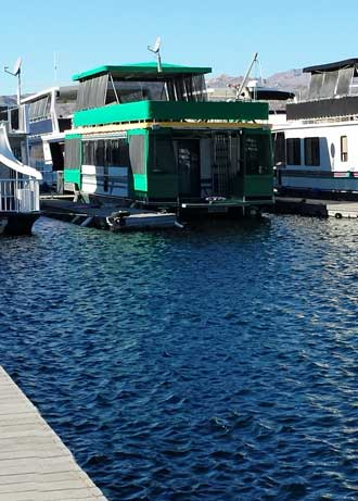 A houseboat in the marina, one of many, Behind: a panorama of the many houseboats