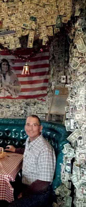 In our Oatman Hotel booth with our dollar overhead, Behind: Live music at the Oatman, dollars everywhere