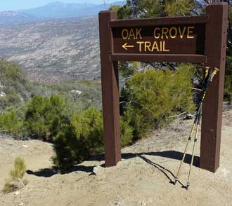 The single track, Oak Grove Trail meets the Oak Grove Road to the summit, Behind: Panorama of the valley, Behind: Panorama of the valley showing location of Jojoba Hills