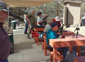 The air gun range, Behind: A live band and free meal the last day of the month