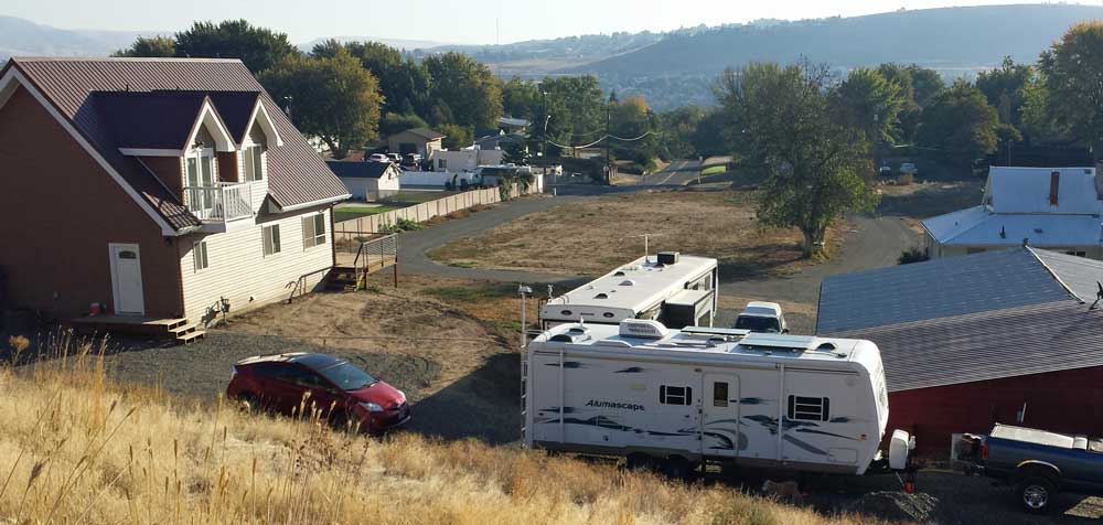 Our camp location with Wayne and Char, Behind: night view of Clarkston Washington and Lewiston, Idaho