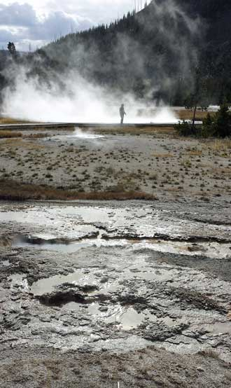 Midway Geyser pools, Behind: one of the many high temperature pools