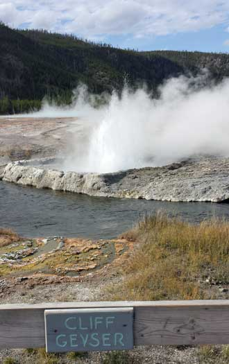Geyser on the Firehole River, Behind: Old Fathful Inn (closed for the season)