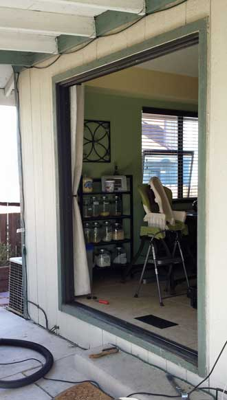 Sliding door removed, Behind: vacuuming the artificial grass