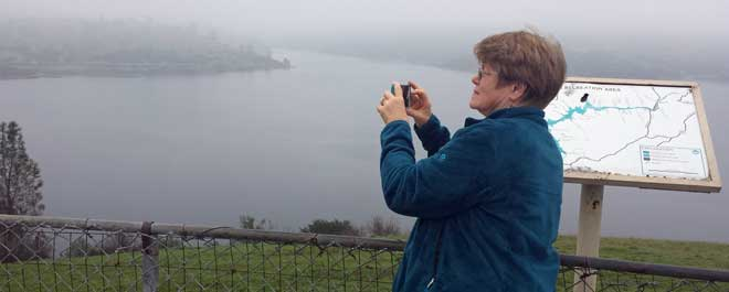 Gwen photographing a foggy Pardee Reservoir