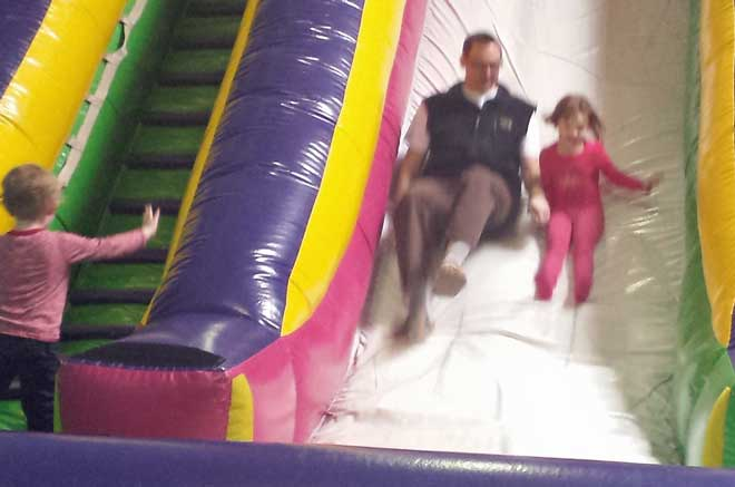 Chloe and Dad on the bouce slide, Noah climbing