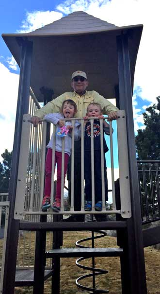 Grandpa with Chloe and Noah on the play equipment