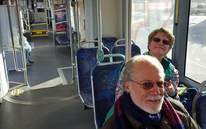 Gwen and Jack riding the Tucson trolley to the Arizona Bowl