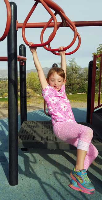 Chloe has learned the monkey bars