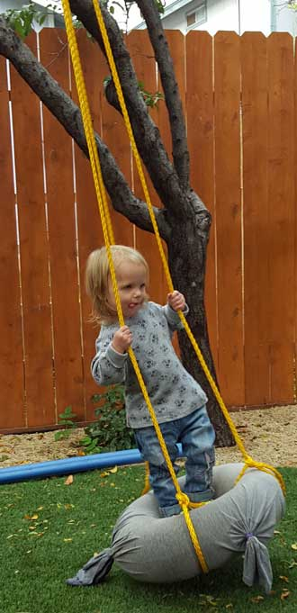 Lucy swinging in her backyard