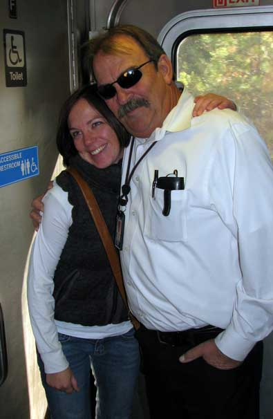 Ron, our train 5 conductor stands with Mindy just before we debark at Colfax