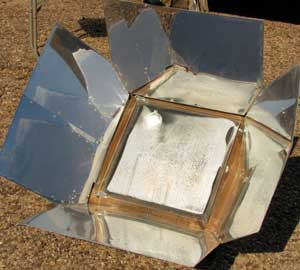 Solar oven baking the potatoes