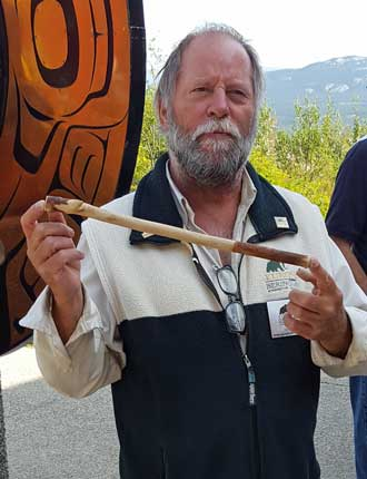 David, our tour guide, instructs us in the use of the atlatl