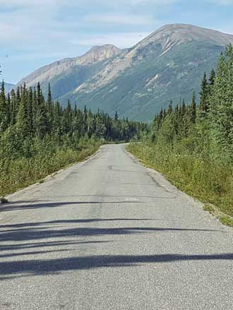 The Cassiar Highway, narrow two lane, paved, no lines
