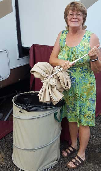 Gwen puts the driver and passenger side curtains in the trash