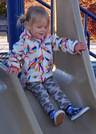 Lucy loves playground play equipment