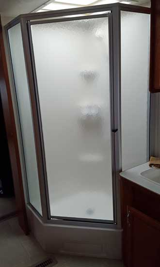 A glass shower is nice in a small trailer