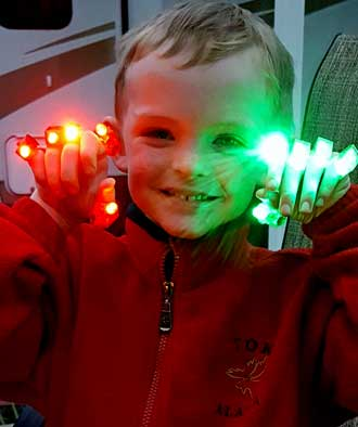 Noah with finger lights