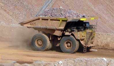 The trucks move the ore to the crusher