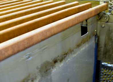 The copper in solution is attracted to stainless steel plates then shaken loose, stacked on 3 ton pallets.