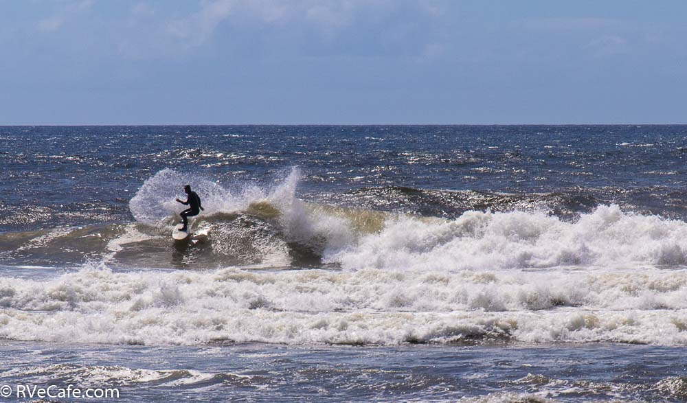 A surfer enjoying the waves off Bandon Beach