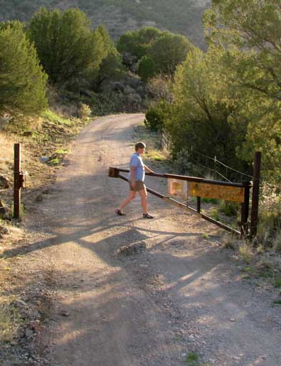 Opening the gate to enter this private RV campground