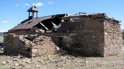 Mangas ghost town deteriorating adobe