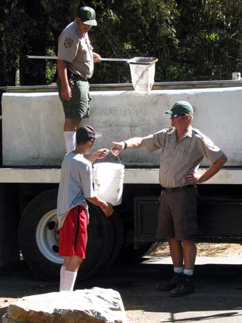 California Fish and Wildlife arrived today to stock the river with fish. All the camp kids came running to help
