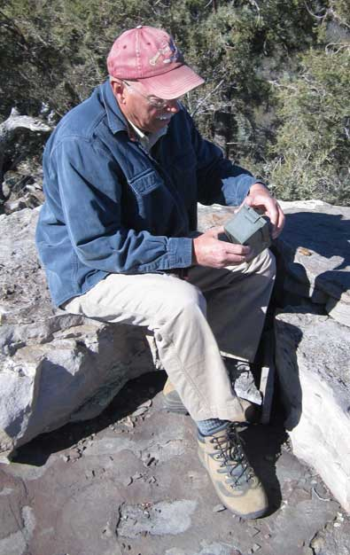 "Ralph finds the cache ""at the top"", note the petroglyphs on the enlargement."