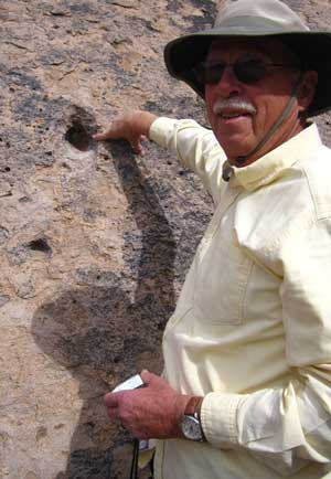 Ralph finds a petroglyph on one of the rocks